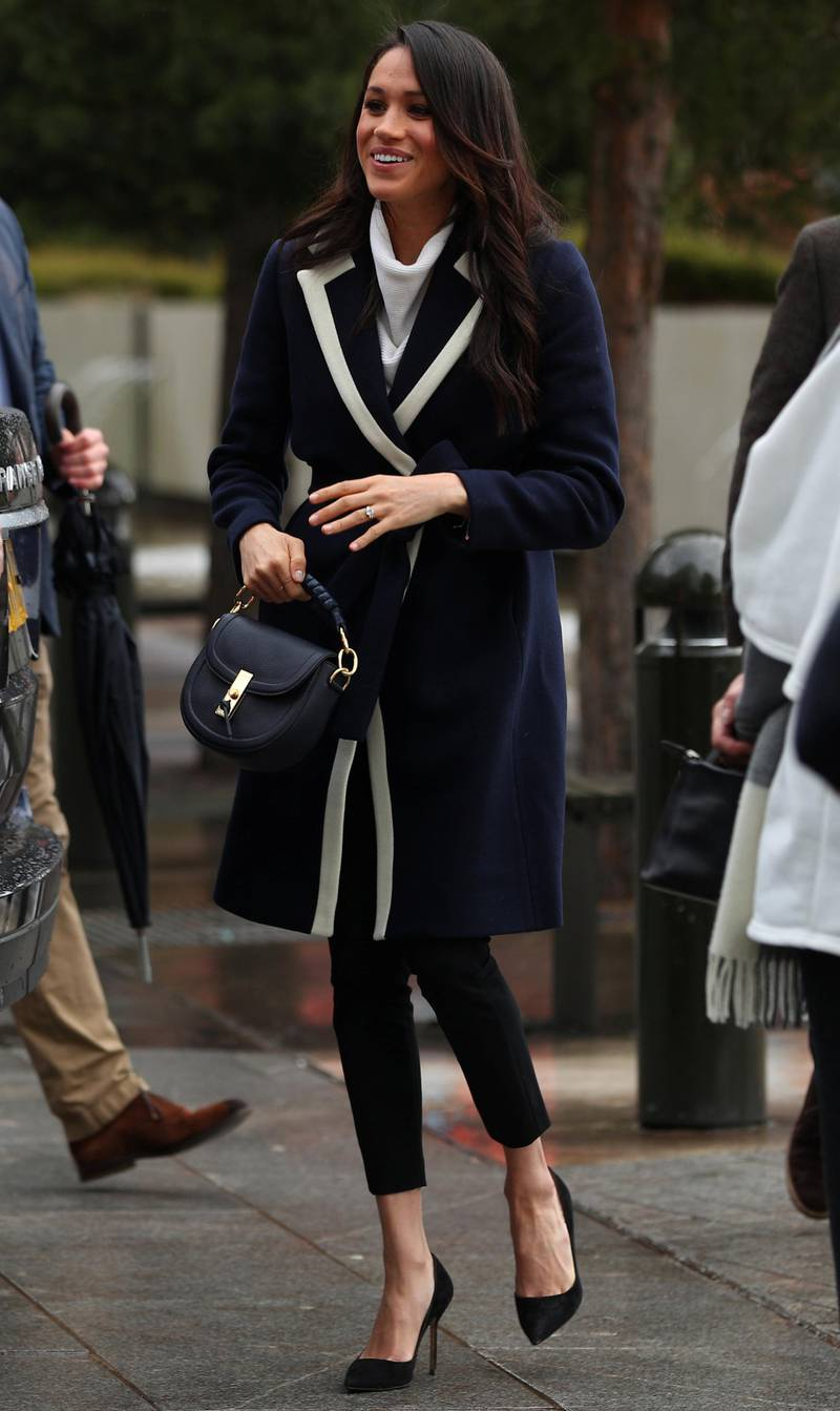 BIRMINGHAM, ENGLAND - MARCH 08:  Meghan Markle arrives with Prince Harry (not pictured) in Birmingham on March 8, 2018 in Birmingham, England.  (Photo by Hannah McKay-WPA Pool/Getty Images)