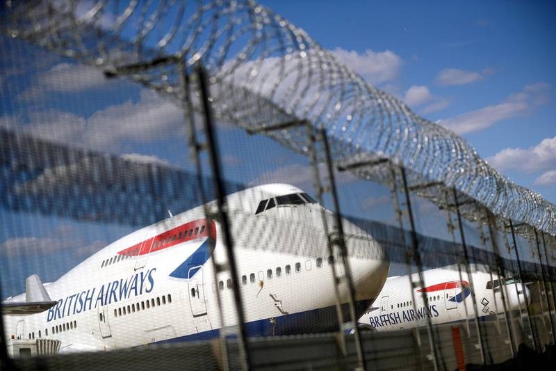 FILE PHOTO: British Airways planes are seen at the Heathrow Airport in London, Britain, July 17, 2020. REUTERS/Hannah McKay/File Photo