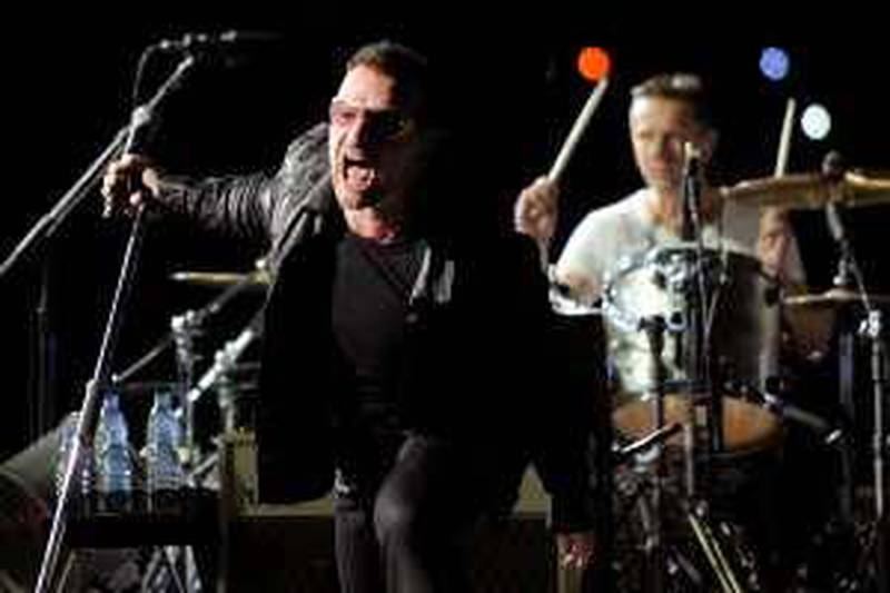Bono, left, and Larry Mullen Jr. of U2 perform during their 360 world tour stop at the Rose Bowl in Pasadena, Calif., Sunday, Oct. 25, 2009. (AP Photo/Chris Pizzello)