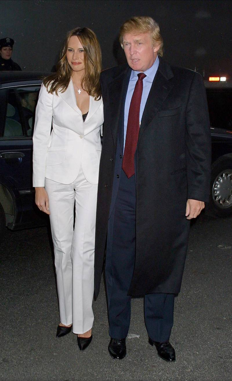 """387976 12: Business tycoon Donald Trump and his girlfriend Melania Knauss arrive for the premiere of """"Moulin Rouge"""" April 17, 2001 at the Paris Theatre in New York City. (Photo by George De Sota/Newsmakers)"""