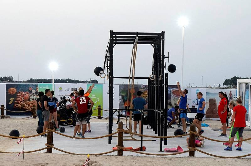 ABU DHABI , UNITED ARAB EMIRATES , APRIL 16   – 2018 :- People doing exercise in the open gym at the Al Bahar at the corniche in Abu Dhabi. ( Pawan Singh / The National ) For Weekender