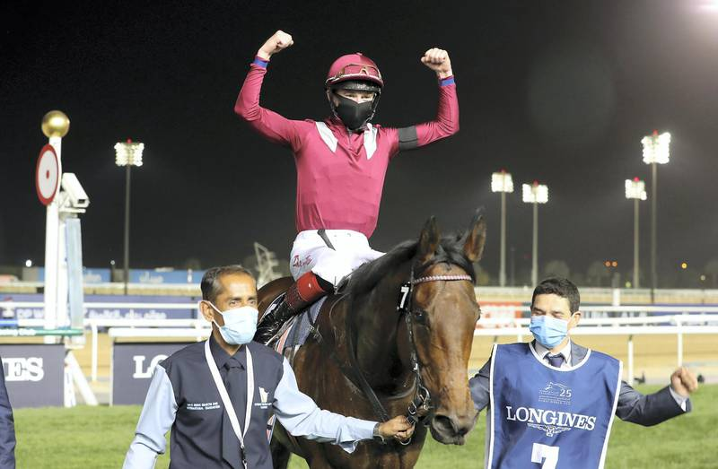 DUBAI , UNITED ARAB EMIRATES , MARCH 27  – 2021 :-  MISHRIFF       (IRE) ridden by DAVID EGAN  ( no 7  ) won the 8th  horse race Longines Dubai Sheema Classic 2410m Turf    during the Dubai World Cup held at Meydan Racecourse in Dubai. ( Pawan Singh / The National ) For News/Sports/Instagram/Big Picture. Story by Amith