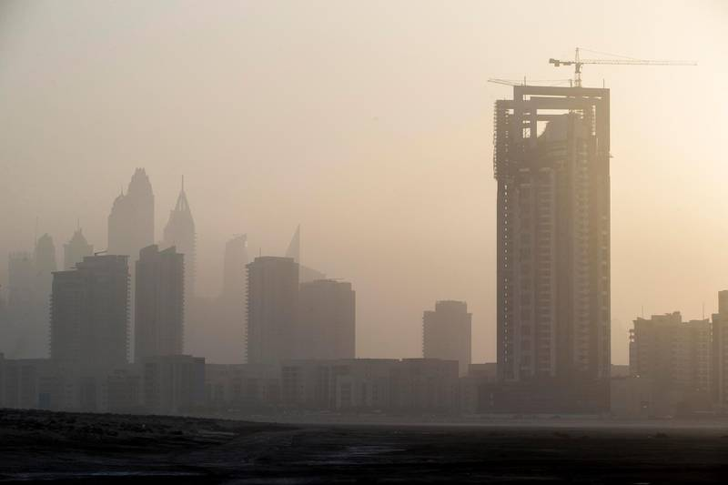 DUBAI, UNITED ARAB EMIRATES, 10 MAY 2017. Standalone photo. As summer temperatures rise visibility drops in the UAE as seen in the dusty sunset over Al Barsha Heights and the Greens. Today saw a heat index of 41 degrees with humidity of 60% while visibility was limited to 4km's. (Photo: Antonie Robertson/The National) ID: STANDALONE. Journalist: None. Section: National. *** Local Caption ***  AR_1005_Standalone_Weather-06.JPG