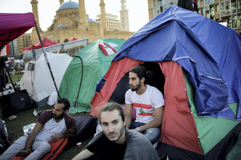 Protesters sit outside tents at Martyr's square in downtown Beirut, Lebanon November 2, 2019. REUTERS/Andres Martinez Casares