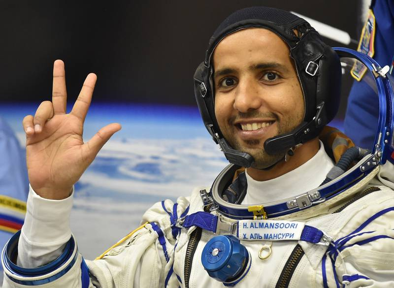 epa07868726 Member of the main crew to the International Space Station (ISS) United Arab Emirates' astronaut Hazza Al Mansouri waves before boarding a Soyuz rocket to the International Space Station (ISS) at the Russian-leased Baikonur cosmodrome in Kazakhstan, 25 September 2019. Mansouri will be the first Emirati in space.  EPA/VYACHESLAV OSELEDKO / POOL