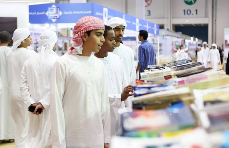 ABU DHABI , UNITED ARAB EMIRATES – May 2 , 2017 : School students looking books at different book stalls during the Abu Dhabi International Book Fair held at Abu Dhabi National Exhibition Centre in Abu Dhabi.  ( Pawan Singh / The National ) For News. Story by Roberta Pennington. ID : 54280 *** Local Caption ***  PS0205- BOOK FAIR24.jpg