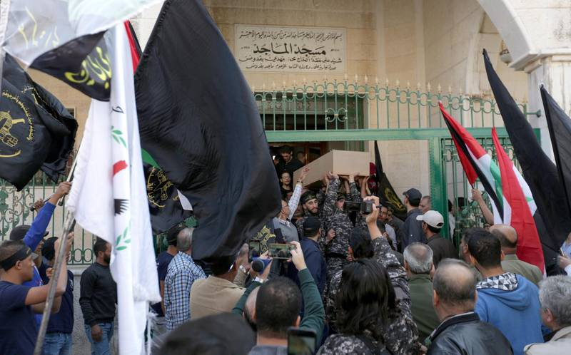 epa07992868 People carry the coffin of Moaz, the son of Akram al-Ajouri, a leader of the Islamic Jihad Movement, during funeral procession at al-Majed Mosque in Damascus, Syria, 13 November 2019. Reports state Moaz was killed along with another person a day earlier by Israeli missiles that hit his house in Mezza area in Damascus. Al-Ajouri survived the attack.  EPA/YOUSSEF BADAWI