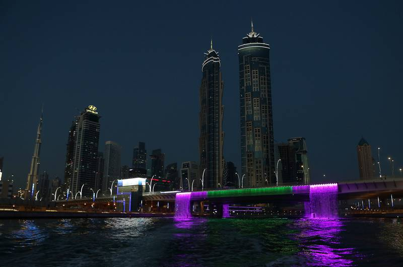 DUBAI , UNITED ARAB EMIRATES – May 17 , 2017 : View of the Dubai Skyline from the Abra at Dubai Water Canal in Dubai. The ticket price for one trip is 25 AED per person and the total time of this ride is around 45 minutes. People can see the Burj Khalifa and other buildings from Abra during the ride. ( Pawan Singh / The National ) For News / Photo Feature. ID No :- 18945 *** Local Caption ***  PS1705- DUBAI CANAL23.jpg