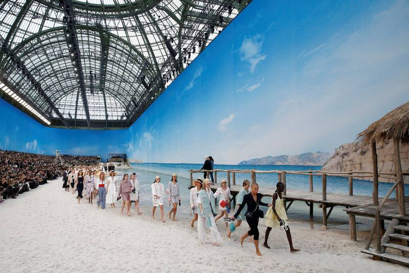Models present creations by German designer Karl Lagerfeld as part of his Spring/Summer 2019 women's ready-to-wear collection show for fashion house Chanel at the Grand Palais transformed as a beach scene during Paris Fashion Week in Paris, France, October 2, 2018. REUTERS/Stephane Mahe