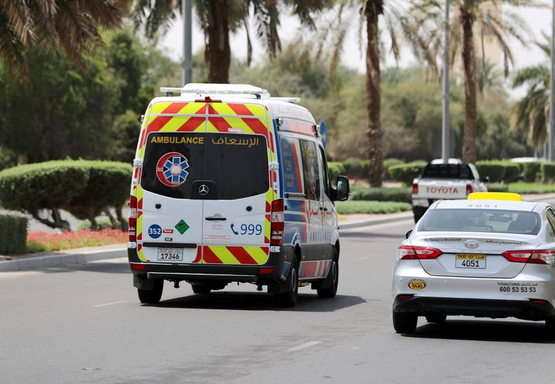 Al Ain, United Arab Emirates - Reporter: N/A: An ambulance goes down a street in Al Ain. Thursday, April 9th, 2020. Al Ain. Chris Whiteoak / The National