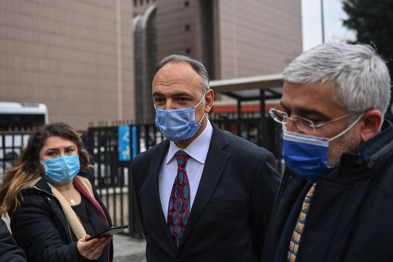 Pilot Noyan Pasin (L) and his lawyer Erem Yucel (R) speak to media in front of the Bakirkoy courthouse in Istanbul, on February 24,2021, after a verdict trial against four pilots, two flight attendants and a private airline official accused of smuggling former Nissan Motor Co. chairman Carlos Ghosn out of Japan. - An Istanbul court on February 24, 2021 sentenced three Turks to four years and two months in prison for helping smuggle former Nissan boss Carlos Ghosn in a musical instrument case from Lebanon to Japan. The court jailed two pilots and an employee of a small private airline who moved the former auto industry giant via Istanbul, while he was out on bail facing financial misconduct charges in December 2019. (Photo by Ozan KOSE / AFP)
