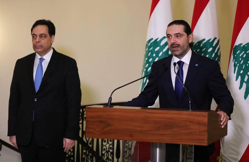 Lebanon's Prime Minister-designate Saad al-Hariri speaks as he stands near Lebanon's caretaker Prime Minister Hassan Diab at the governemt palace in Beirut, Lebanon, December 11, 2020. REUTERS/Mohamed Azakir