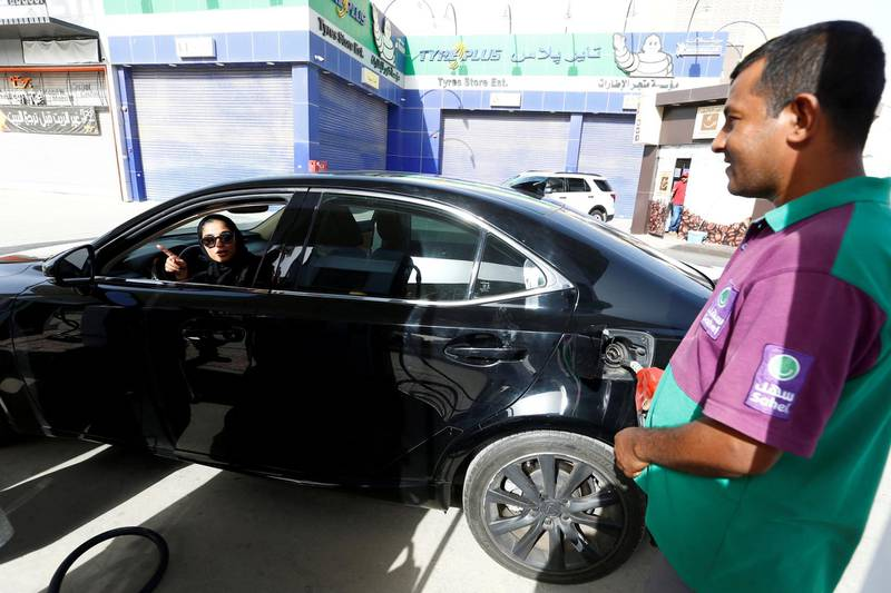 Majdooleen, who is among the first Saudi women allowed to drive in Saudi Arabia, refuels her car as she drives work in Riyadh, Saudi Arabia June 24, 2018. REUTERS/Faisal Al Nasser