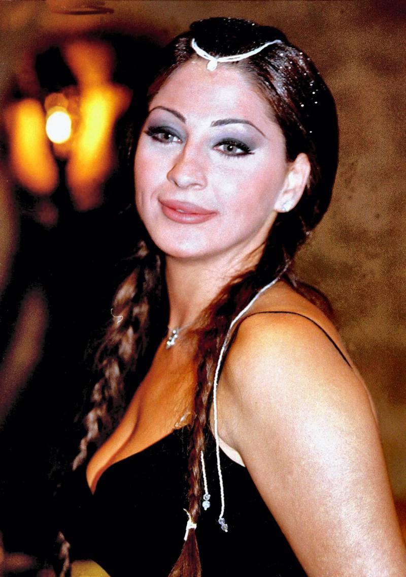"""Lebanese singer Elissa poses for a picture late 30 October 2000 at a nightclub in Beirut. Elissa, whose real name is Elissar Khoury, started her career as an actress with the """"les diseurs"""" theatre troupe, before she had launched a videoclip for her song """"Baddi Doub"""", which was a great success. Elissa's forthcoming album is """"Akherta Maak"""", and a new video clip will follow. (film) (Photo by RAMZI HAIDAR / AFP)"""