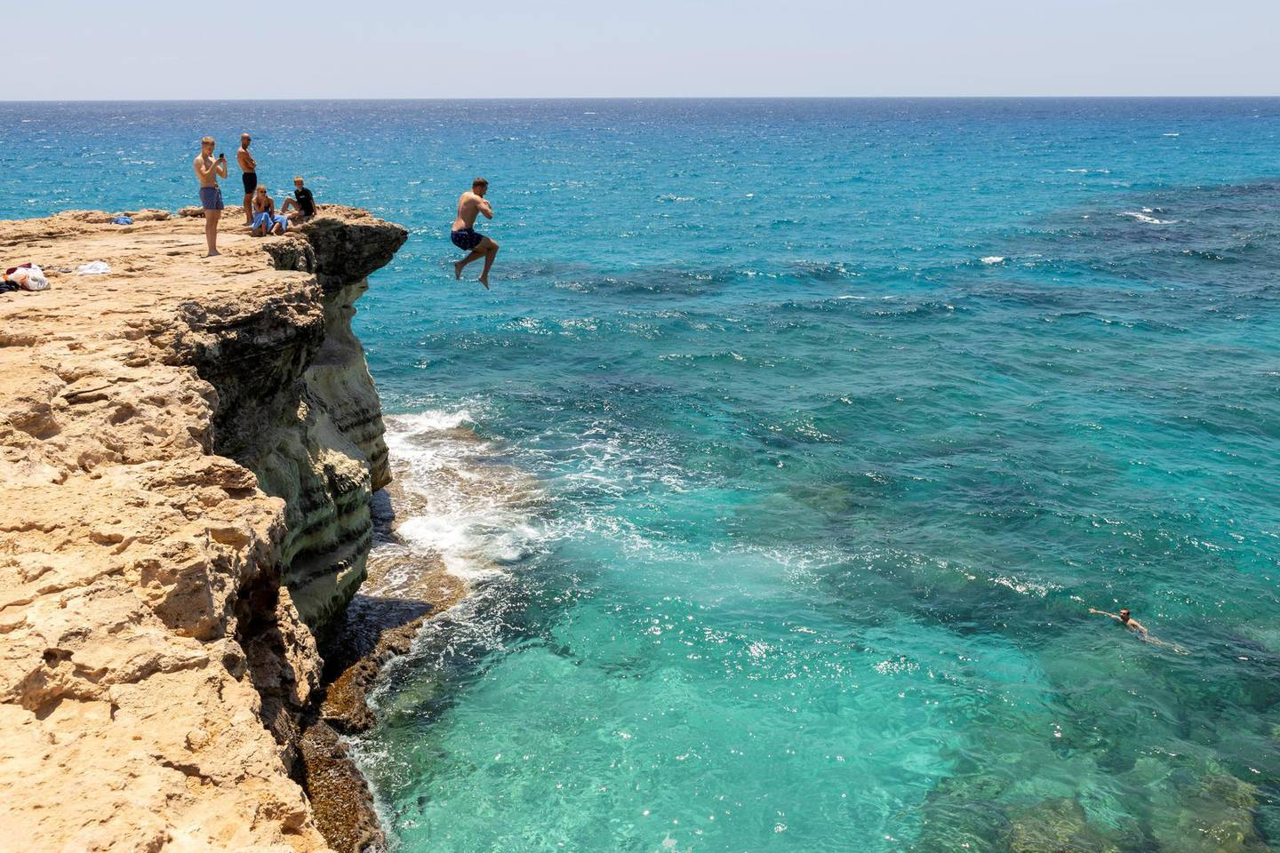 AYIA NAPA, CYPRUS - JULY 17 : The sea caves with the turquoise waters at Cape Greco on July 17, 2020 in Ayia Napa, Cyprus. Cape Greco or Cavo Greco is a headland in the southeastern part of the island of Cyprus. It is at the southern end of Famagusta Bay and forms part of Ayia Napa Municipality. Located between the towns of Ayia Napa and Protaras, both of which are popular tourist resorts. It is frequently visited by many tourists for its natural beauty. Cape Greco is a National Forest Park with unique flora and fauna and is protected nature park. (Photo by Athanasios Gioumpasis/Getty Images)