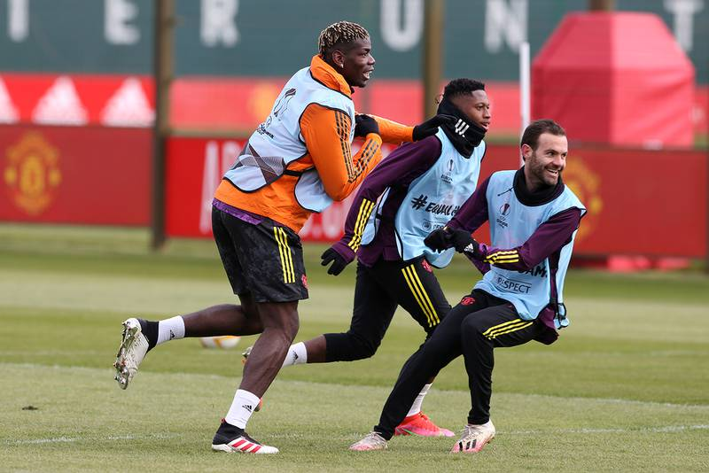 MANCHESTER, ENGLAND - APRIL 07:  Paul Pogba, Juan Mata of Manchester United and Fred in action during a first team training session at Aon Training Complex on April 7, 2021 in Manchester, England. (Photo by Matthew Peters/Manchester United via Getty Images)