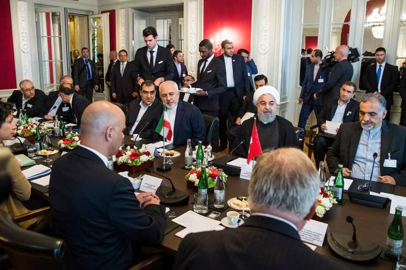 epa06860635 Swiss Federal President Alain Berset (2-L), Iranian President Hassan Rohani (2-R) and their delegation members sit at a table at the beginning of the delegation meeting, in Bern, Switzerland, 03 July 2018. Rouhani is on a two-days visit to Switzerland.  EPA/PETER KLAUNZER