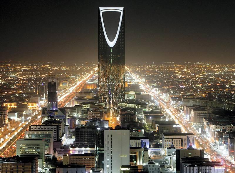 The Kingdom Tower stands in the night above the Saudi capital Riyadh November 16, 2007.  REUTERS/Ali Jarekji  (SAUDI ARABIA) - GM1DWPNRBQAA