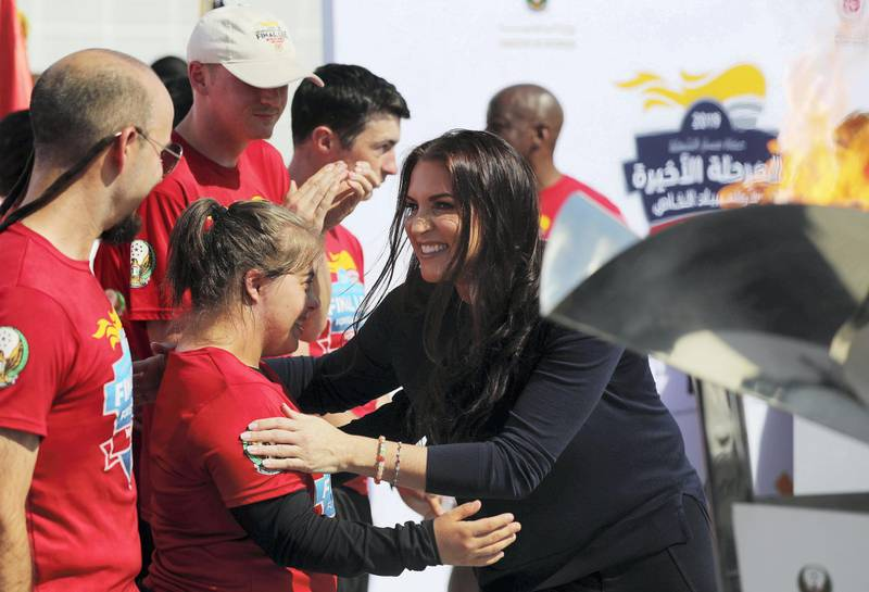 Abu Dhabi, United Arab Emirates - March 13, 2019: Stephanie McMahon the Chief brand officer of WWE hugs Chaica Al Qassimi during the arrival of Special Olympic torch team at Louvre Abu Dhabi. Wednesday the 13th of March 2019 at Louvre, Abu Dhabi. Chris Whiteoak / The National