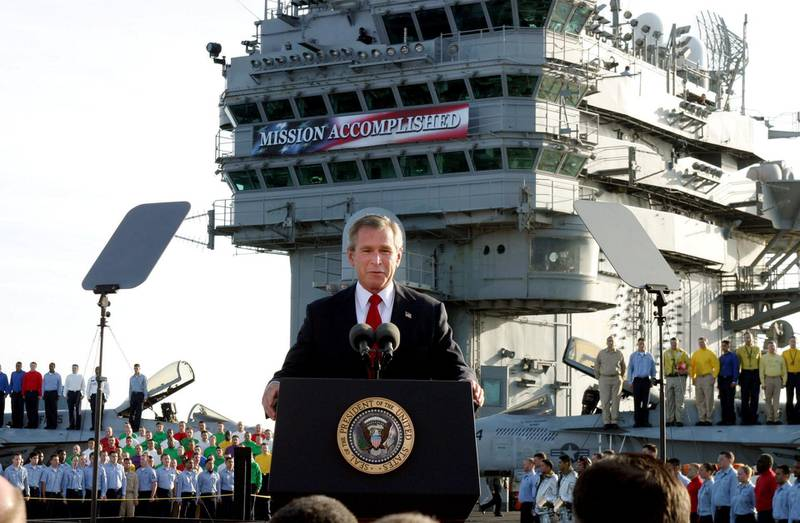 """** FILE ** President Bush declares the end of major combat in Iraq as he speaks aboard the aircraft carrier USS Abraham Lincoln off the California coast, in this May 1, 2003 file photo.  Over and over, President Bush confidently promised to """"solve problems, not pass them on to future presidents and future generations."""" As the clock runs out on his eight-year presidency, a tall stack of troubles remain and Bush's words seem to ring hollow.  (AP Photo/J. Scott Applewhite, File)"""