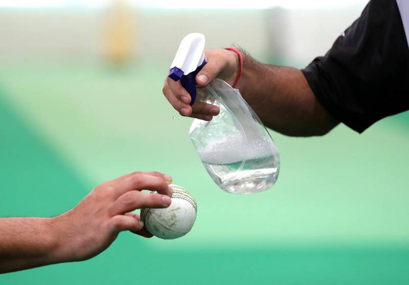 Dubai, United Arab Emirates - Reporter: Paul Radley. Sport.  The ball is disinfected. The UAE cricket team are back at training at the ICC academy after the government have eased restrictions due to Coivd-19/Coronavirus. Sunday, June 7th, 2020. Dubai. Chris Whiteoak / The National