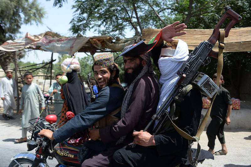 (FILES) In this file photo taken on June 16, 2018, Afghan Taliban militants ride a motorbike as they took to the street to celebrate ceasefire on the second day of Eid in the outskirts of Jalalabad. The Taliban have offered a brief ceasefire to their US counterparts in Doha, two insurgent sources said on January 16, a move which could allow the resumption of talks seeking a deal for Washington to withdraw troops from Afghanistan. / AFP / NOORULLAH SHIRZADA