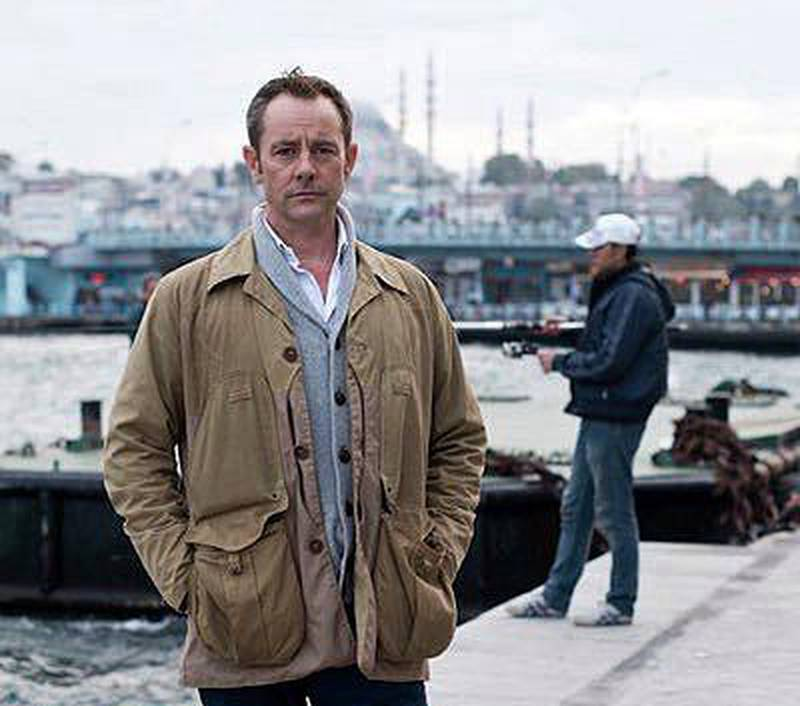"""FILE - Former British army officer James Le Mesurier stands near the Golden Horn in this undated file photo, in Istanbul.  The lifeless body of James Le Mesurier was found early Monday Nov. 11, 2019, in Istanbul, Turkey.  Le Mesurier, a former British army officer who helped found the """"White Helmets"""" volunteer organization in Syria, has been found dead in Istanbul, Turkish officials and news reports said Monday. (AP Photo/File)"""