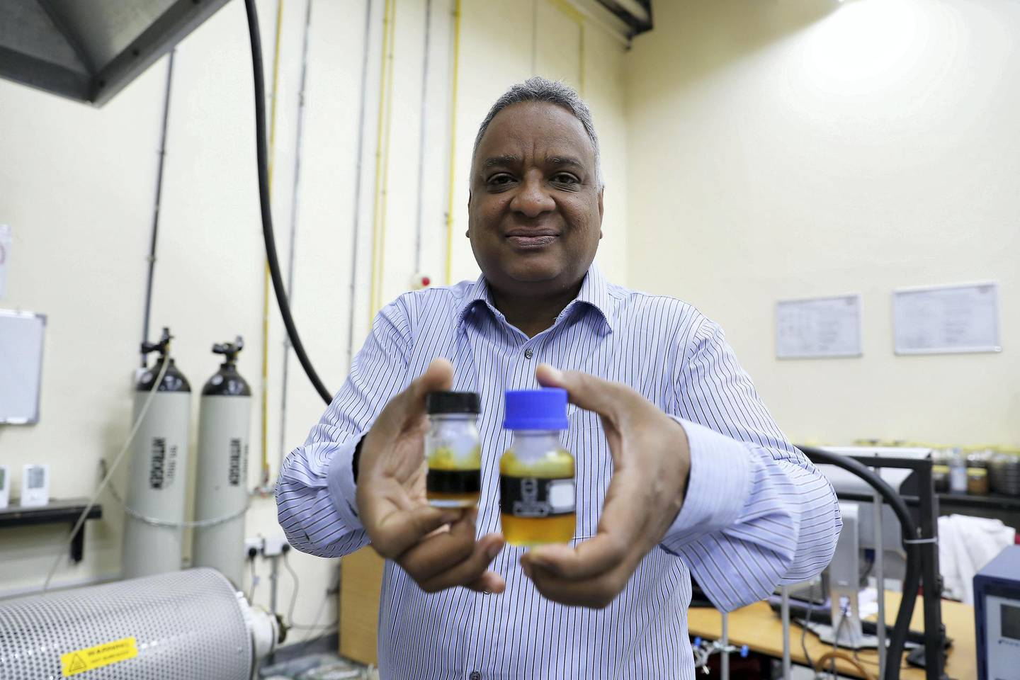 SHARJAH ,  UNITED ARAB EMIRATES , May 22 – 2019 :- Dr Yassir Makkawi , Professor at the Chemical Engineering Department showing the Date Palm bio-fuel inside the lab at the American University of Sharjah in Sharjah. ( Pawan Singh / The National ) For News. Story by Dan Sanderson