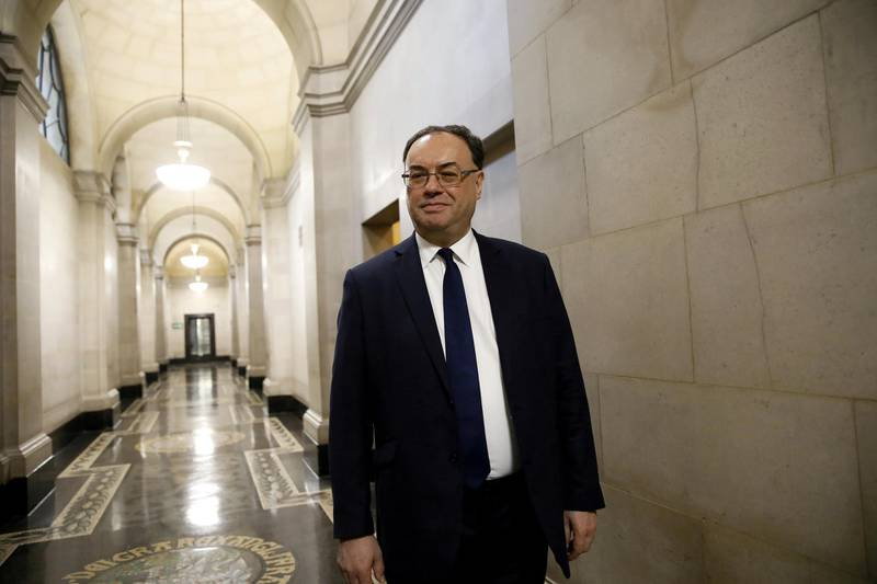 FILE PHOTO: Bank of England Governor Andrew Bailey poses for a photograph on the first day of his new role at the Central Bank in London, Britain March 16, 2020. Tolga Akmen/Pool via REUTERS/File Photo