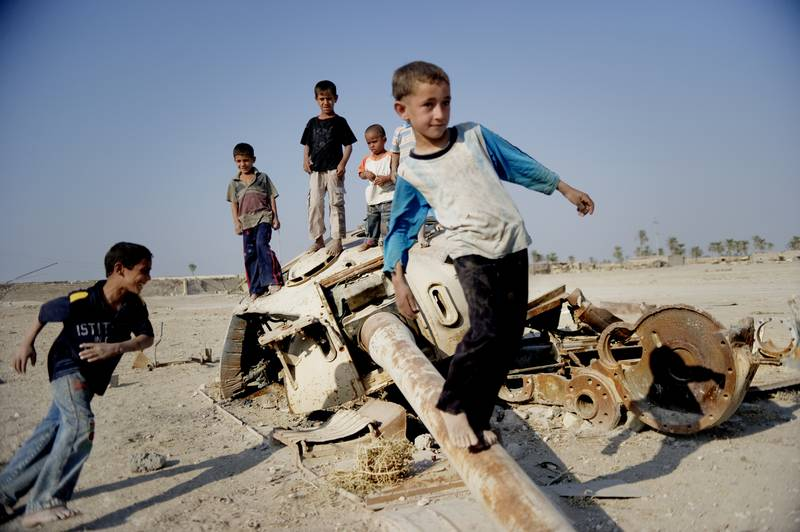 In the wake of disasters, children are left traumatized and incapable of overcoming the psychological impact. These Children in South Iraq use the debris of war as their playground.Photo: Redd Barna/Save the Children