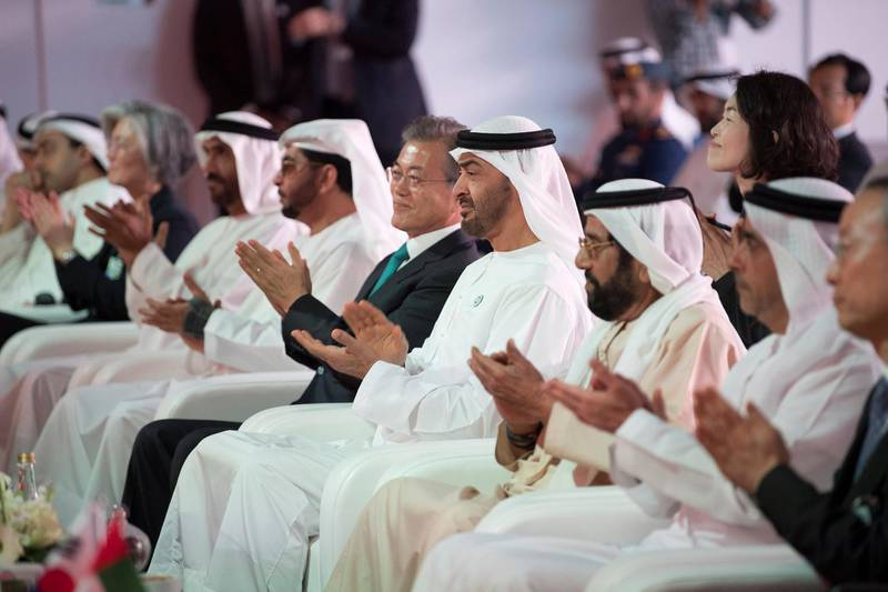 AL DHAFRA, ABU DHABI, UNITED ARAB EMIRATES - March 26, 2018: HH Lt General Sheikh Saif bin Zayed Al Nahyan, UAE Deputy Prime Minister and Minister of Interior (2nd R), HH Sheikh Tahnoon bin Mohamed Al Nahyan, Ruler's Representative in Al Ain Region (3rd R) HH Sheikh Mohamed bin Zayed Al Nahyan Crown Prince of Abu Dhabi Deputy Supreme Commander of the UAE Armed Forces (4th R), HE Moon Jea-In, President of South Korea (5th R),  HH Sheikh Hamdan bin Zayed Al Nahyan, Ruler's Representative in Al Dhafra Region (6th R) and HH Sheikh Nahyan Bin Zayed Al Nahyan, Chairman of the Board of Trustees of Zayed bin Sultan Al Nahyan Charitable and Humanitarian Foundation (7th R), attend the Unit One Construction Completion Celebration, at Barakah Nuclear Energy Plant.   ( Abdullah Al Junaibi ) ---