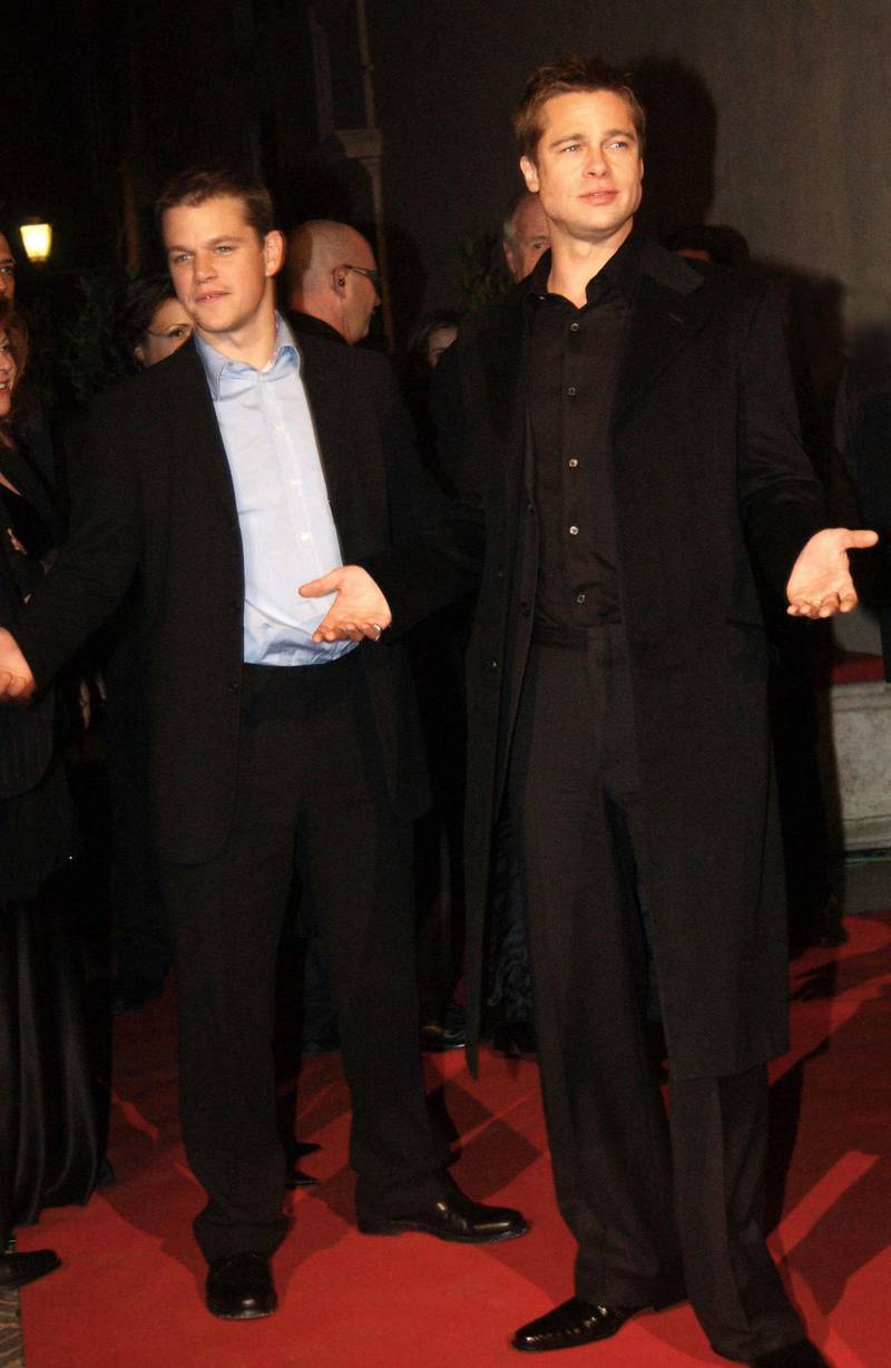 """ROME, ITALY - DECEMBER 10:  Actors Matt Damon and Brad Pitt (right) attend the aftershow party following the European premiere of """"Ocean's Twelve,"""" the sequel to """"Ocean's Eleven,"""" on December 10, 2004 at the Palazzo Venezia in Rome, Italy. (Photo by Franco Origlia/Getty Images)"""