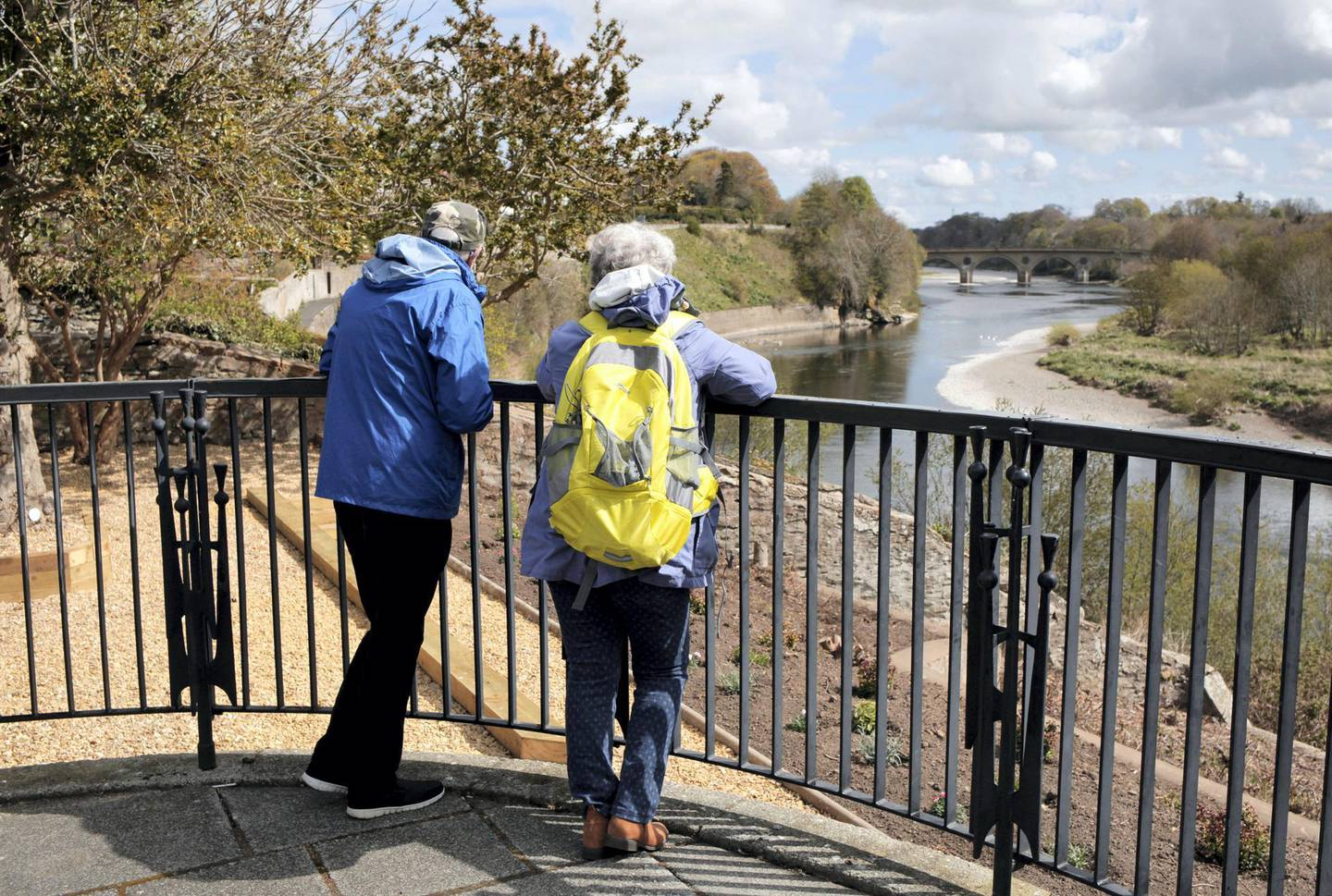 Tourists look out over the River Tweed, which acts as the border between Scotland and England, towards Coldstream Bridge. Photograph: Stuart Boulton