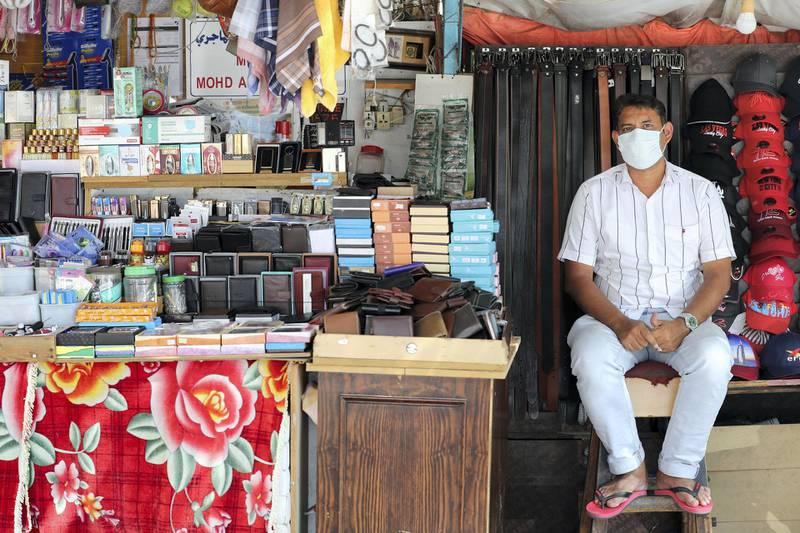Dubai, United Arab Emirates - Reporter: N/A. News. Coronavirus/Covid-19. A man sits at his stall in Bur Dubai. Saturday, October 17th, 2020. Dubai. Chris Whiteoak / The National