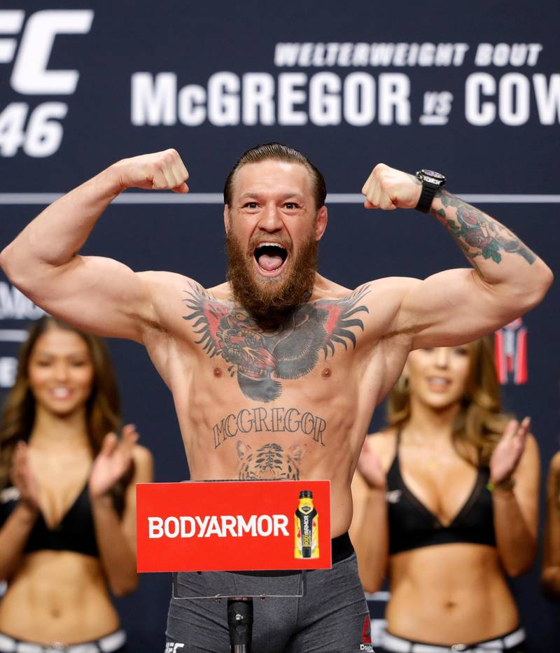LAS VEGAS, NEVADA - JANUARY 17: Welterweight fighter Conor McGregor poses on the scale during a ceremonial weigh-in for UFC 246 at Park Theater at Park MGM on January 17, 2020 in Las Vegas, Nevada. McGregor will face Donald Cerrone at UFC 246 on January 18 in Las Vegas.   Steve Marcus/Getty Images/AFP