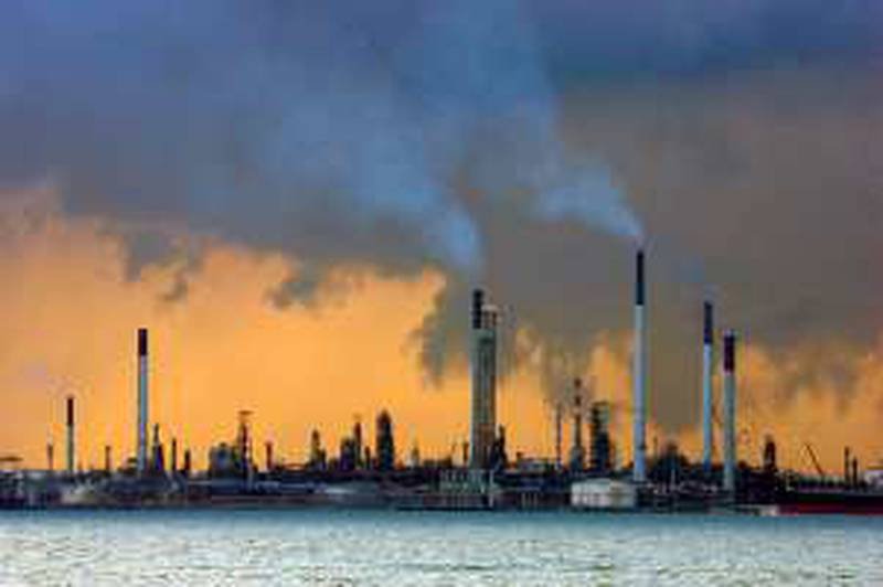 A view of an oil refinery off the coast of Singapore March 14, 2008. Oil slipped below $110 on Friday as investors took profits after prices hit a record $111 in the previous session, but the depressed dollar was seen limiting losses.   REUTERS/Vivek Prakash (SINGAPORE)