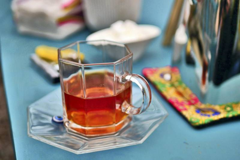 Pictured: Tea is served in a pretty glass with a Turkish evil eye placed on the saucer. Owner Laila Haidari opened the restaurant 10 years ago with the intention of supporting herself and a rehabilitation clinic for drug addicts. Photo by Charlie Faulkner