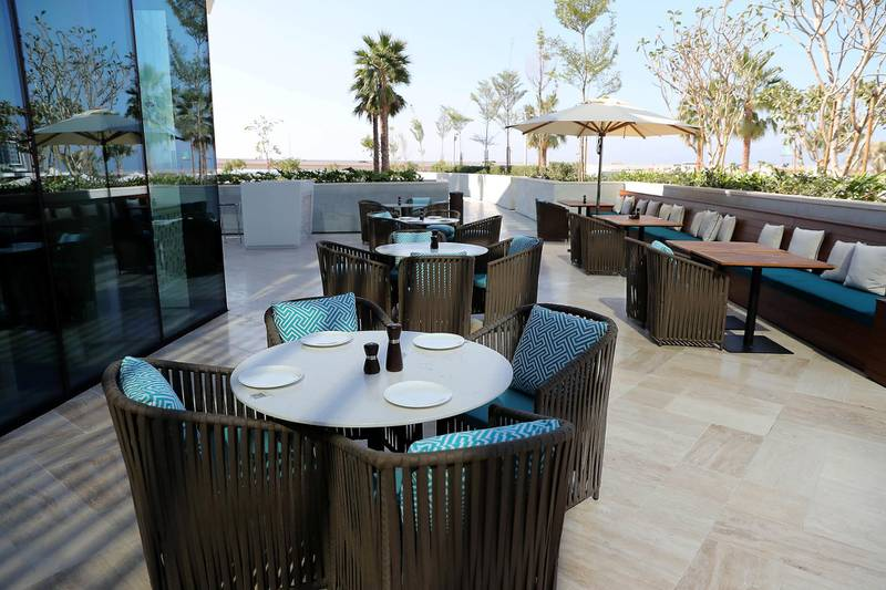 DUBAI, UNITED ARAB EMIRATES , December 24 – 2020 :-  Outside sitting area of The Restaurant at the Address Beach Resort near Jumeirah Beach Residences in Dubai. ( Pawan Singh / The National ) For Lifestyle. Story by Janice
