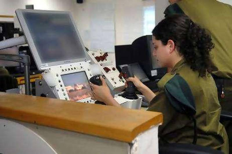 """An unidentified Israeli soldier operates """"Spot and Shoot"""", a system that allows her to fire a remotely controlled machine-gun to execute Palestinians who approach the fence around Gaza by pressing a button on her joystick. Israel is at the forefront of developing such """"remote killing"""" technology. (copyright: Israel Defence Forces) To go with Jonathan Cook story for Foreign"""