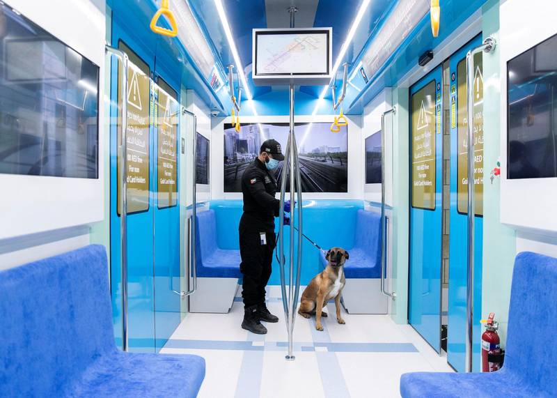 DUBAI, UNITED ARAB EMIRATES. 15 NOVEMBER 2020. Transport Security Department officer with a police dog, at Hamdan Smart Station for Simulation and Training. The training facility of the Transport Security Department in Dubai aims to enhance security efforts and increase the readiness of security and law enforcement personnel. Equipped with the latest tools, the station utilises virtual reality and simulation technologies to provide comprehensive scenario-based emergency training.(Photo: Reem Mohammed/The National)Reporter:Section: