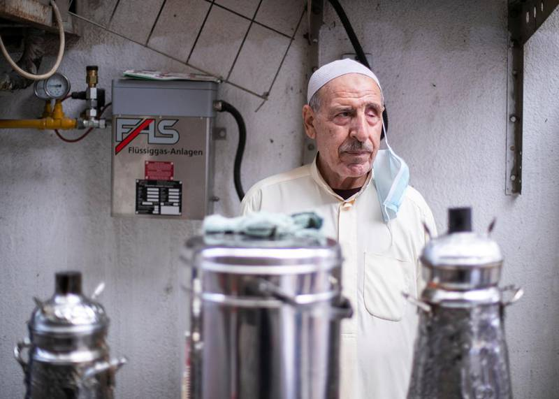DUBAI, UNITED ARAB EMIRATES.  7 FEBRUARY 2021. Hussain Al Khawali runs his coffee stall in Al Sabkha. He's been in the same neighborhood, serving coffee to the community, for 40 years. Photo: Reem Mohammed / The NationalReporter: