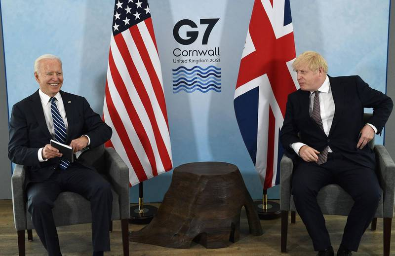 Britain's Prime Minister Boris Johnson (R) and US President Joe Biden and react during a bi-lateral meeting at Carbis Bay, Cornwall on June 10, 2021, ahead of the three-day G7 summit being held from 11-13 June.  G7 leaders from Canada, France, Germany, Italy, Japan, the UK and the United States meet this weekend for the first time in nearly two years, for the three-day talks in Carbis Bay, Cornwall. -   / AFP / Brendan Smialowski