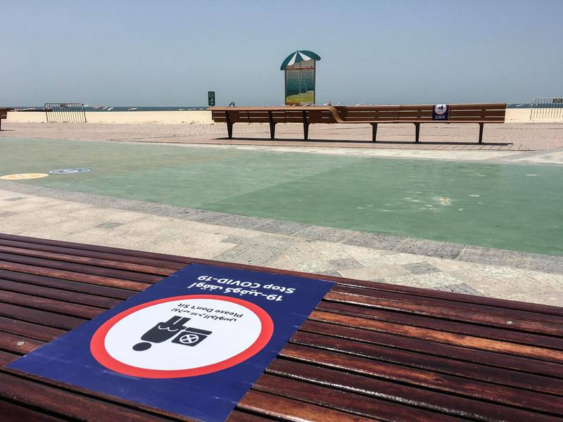 DUBAI, UNITED ARAB EMIRATES. 17 MAY 2020. Preparations along the opening of parks along the Dubai Beach. Protocol and rules for using the open beach walk way in Jumereirah. (Photo: Antonie Robertson/The National) Journalist: STANDALONE. Section: National.