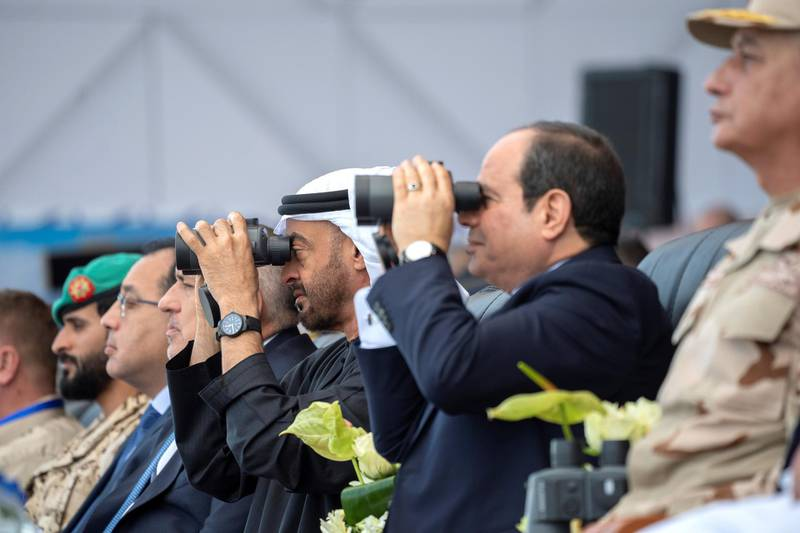 BERENICE, EGYPT - January 15, 2020: HH Sheikh Mohamed bin Zayed Al Nahyan, Crown Prince of Abu Dhabi and Deputy Supreme Commander of the UAE Armed Forces (3rd R) and HE Abdel Fattah El Sisi, President of Egypt (2nd R), attend the opening ceremony of BereniceMilitary Base.  ( Hamad Al Kaabi /  Ministry of Presidential Affairs ) —
