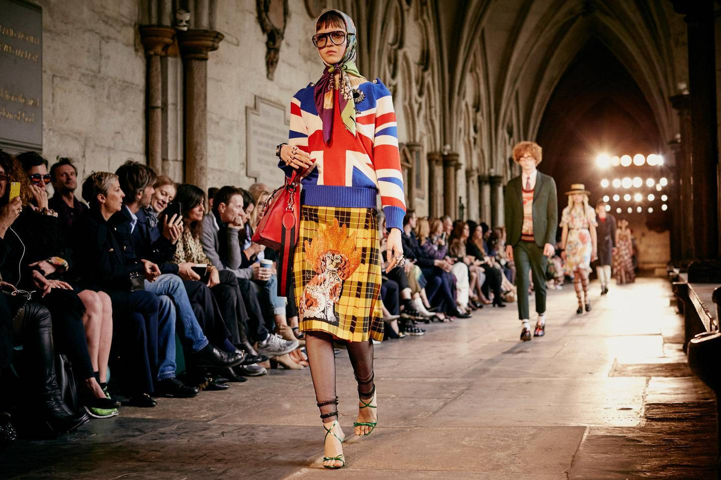 A handout photo of a model walking the runway during the Gucci Cruise 2017 fashion show at the Cloisters of Westminster Abbey on June 2, 2016 in London, England (Courtesy: Gucci) *** Local Caption ***  lm08se-gucci-cruise01.jpg