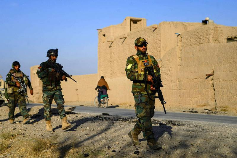 Afghan National Army (ANA) and Afghan Local Police (ALP) forces patrol during a cleaning operation in Pashtun Zarghun district of Herat province on November 28, 2020. (Photo by Hoshang Hashimi / AFP)