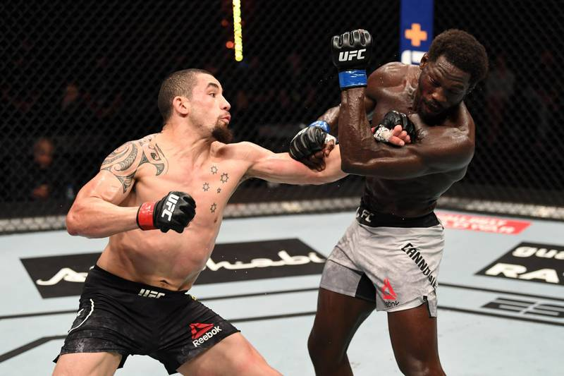 ABU DHABI, UNITED ARAB EMIRATES - OCTOBER 25:  (L-R) Robert Whittaker of Australia punches Jared Cannonier in their middleweight bout during the UFC 254 event on October 25, 2020 on UFC Fight Island, Abu Dhabi, United Arab Emirates. (Photo by Josh Hedges/Zuffa LLC via Getty Images)