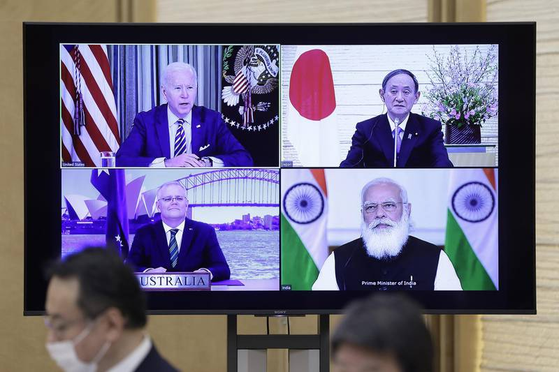 U.S. President Joe Biden, top left, Yoshihide Suga, Japan's prime minister, top right, Scott Morrison, Australia's prime minister, bottom left, and Narendra Modi, India's prime minister, on a monitor during the virtual Quadrilateral Security Dialogue (Quad) meeting at Sugas official residence in Tokyo, Japan, on Friday, March 12, 2021.  Photographer: Kiyoshi Ota/Bloomberg