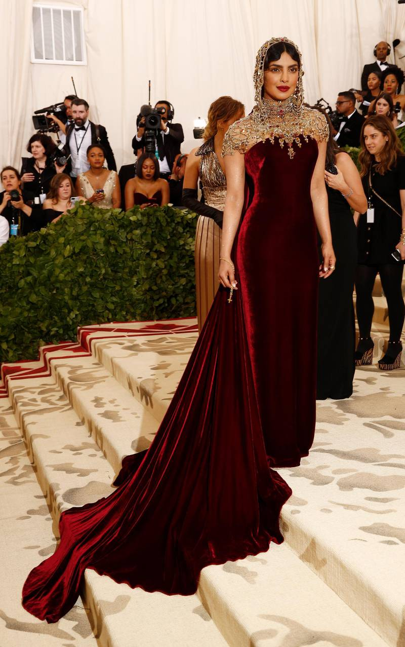 epa06718054 Priyanka Chopra arrives on the red carpet for the Metropolitan Museum of Art Costume Institute's benefit celebrating the opening of the exhibit 'Heavenly Bodies: Fashion and the Catholic Imagination' in New York, New York, USA, 07 May 2018. The exhibit will be on view at the Metropolitan Museum of Art's Costume Institute from 10 May to 08 October 2018.  EPA-EFE/JUSTIN LANE