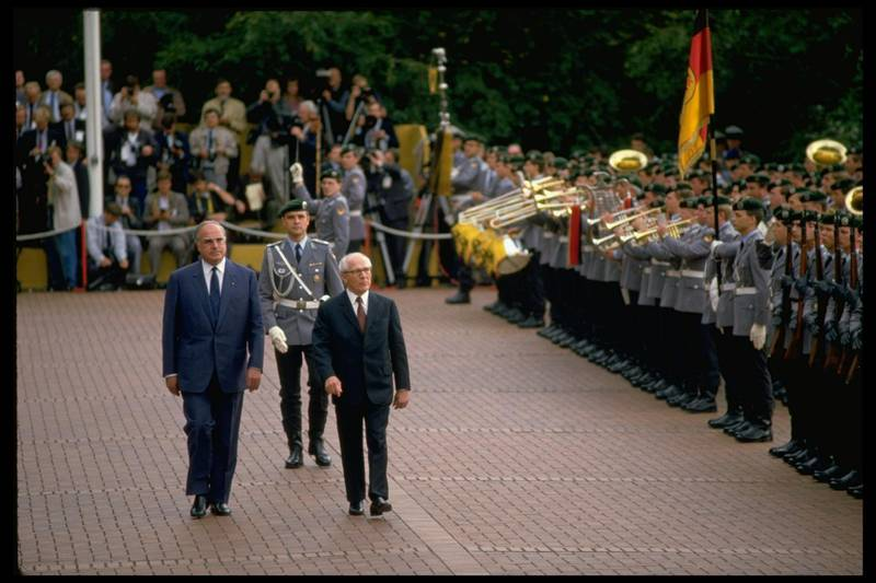 (L-R) West German Chancellor Helmut Kohl and East German leader Erich Honecker being greeted by brass band during visit to Bonn.  (Photo by Chris Niedenthal/The LIFE Images Collection via Getty Images/Getty Images)